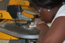 Dwaynasia Webb operates the scroll saw for a project she is building.