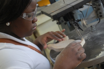 Dwaynasia Webb cuts out a pelican image on the scroll saw in the Ag Shop.
