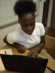 Orriyonna Willis is working with her partner in class to create a website for learning website publishing skills.