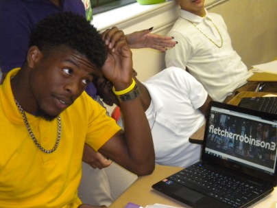 """""""Mrs. A, Check this out."""" --Fletcher Robinson shows off his homepage design in Broadcast Journalism class."""