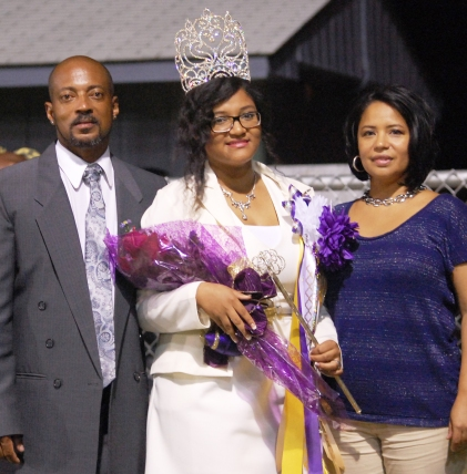 Homecoming Queen Uniqua Stevenson and her parents