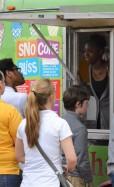 High School and Junior High School students buying sno cones.