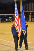 Daniela Miranda and Taeshia Gulley, exiting with the colors after the National Anthem.
