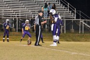 #2 Shaun Monroe speaks to the lead official prior to the kickoff as Stephen Faulk looks on.
