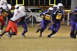 #28 Courtney Lovett with the carry, guarded by #60 Dan Stewart, Offensive Lineman.