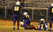 #58 Kameria Alford and #77, Cameron Manual with the tackle, and #2 Shaun Monroe