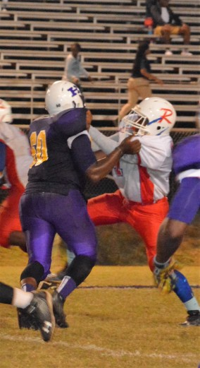 Defensive Tackle Dan Stewart grapples with the offensive lineman for Ringgold.