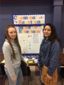 "Chandler Glanc and Maria Lumbreras with their Chemistry project titled ""Chemical Reactions: Made to Entertain"""