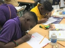 Stanley and Joshua solve math problems to complete the chicken puzzle worksheet.